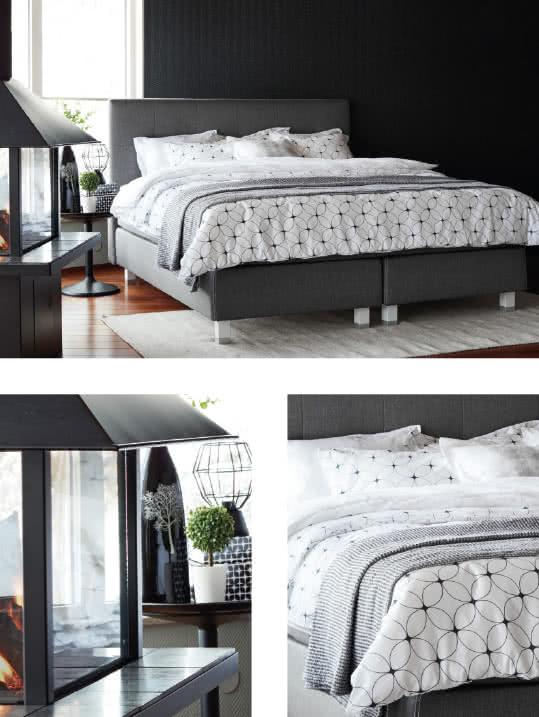 Svartvitt sovrum med grå toner